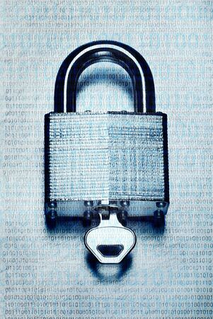 Concept digital security and encryption with binary code overlaid on steel padlock and key on scratched steel surface Banco de Imagens