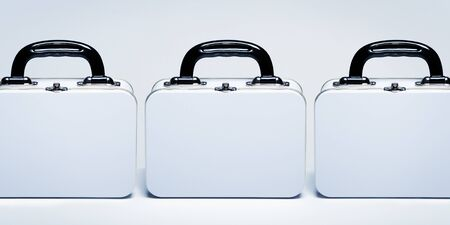 Row of white metal retro lunch boxes with copy space on white table Banco de Imagens