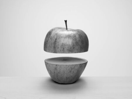 Black and white apple cut in half, separated and floating apart. Concept: parts, apart, float, levitate, separation Banco de Imagens