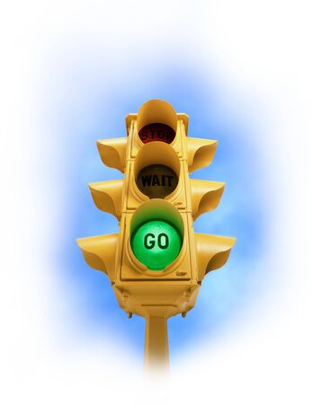 Upward view of  tall vintage yellow traffic signal with green GO light on white vignette background