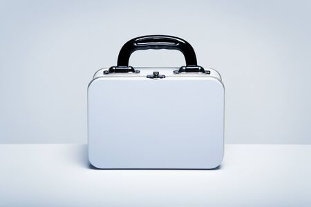 Plain white metal retro lunchbox with copy space on white table