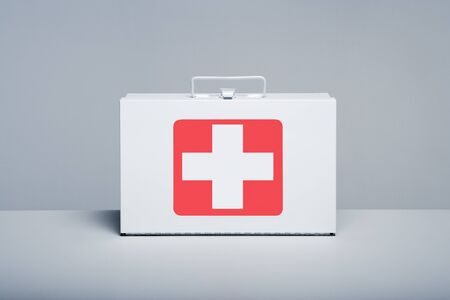 Be prepared, tin first aid kit with cross emblem on grey background Banco de Imagens
