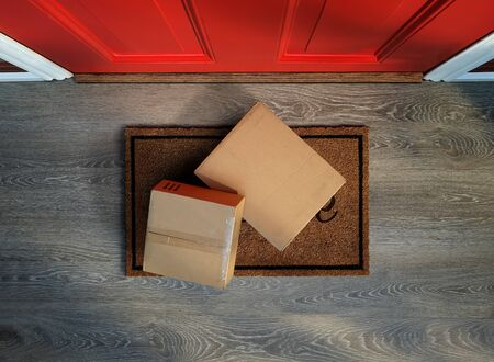Delivered to the door, e-commerce purchases on welcome mat. Add your own labels Reklamní fotografie