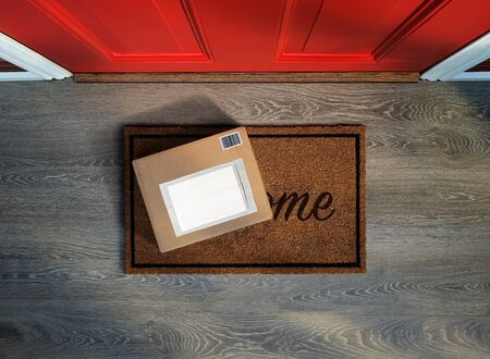 Delivered outside door, e-commerce purchase on welcome mat. Add your own copy and label door, e-commerce purchase sitting on welcome mat. Add your own copy and label