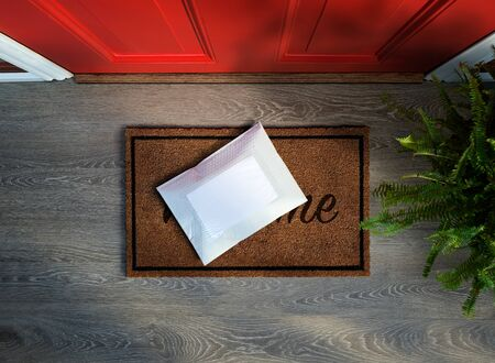 Messenger envelope pack delivered to door step. Overhead view. Copy space Imagens