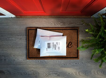 Messengered envelope packages delivered to door step. Overhead view.