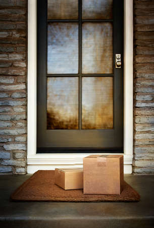Ecommerce boxes delivered to the front door of home. Add your own copy and labels. Copy space. Standard-Bild