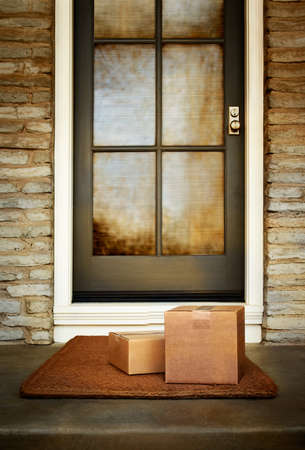 Boxes from online purchase delivered to the front door of home. Add your own copy and labels. Copy space.