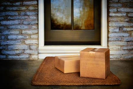 Delivered outside the door, e-commerce purchase boxes on door mat. Add your own copy and label Standard-Bild