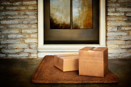 Delivered outside the door, e-commerce purchase boxes on door mat. Add your own copy and label