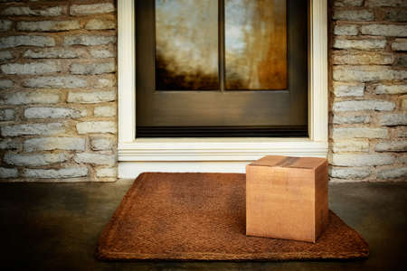 Delivered outside the door, online purchase box on door mat. Add your own copy and label Standard-Bild