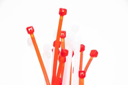 many red and white zip ties isolated on white
