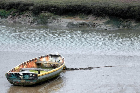 Boat moored in the mud