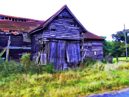 Old barn beside road Stock Photo