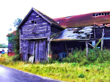 Old barn beside road photo