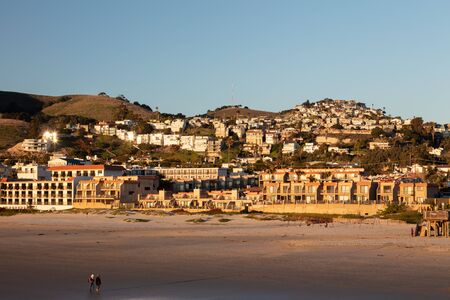 Downtown Pismo Beach view from the boardwalk at sunset.
