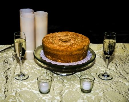 stemware: White Tablecloth Black Background Wine Glasses and Cak Stock Photo