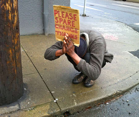 Panhandler in Portland, Oregon, takes on prayerful pose to entice motorists to donate spare change Editorial