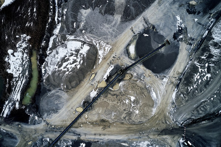pebble plant, a mine of gravel, heaps, machines, production in a winter environment seen from a drone 写真素材