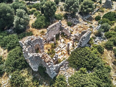 top drone view of ancient ruins of stone in the ancient city of Patara. aerial shot turkey, antalya