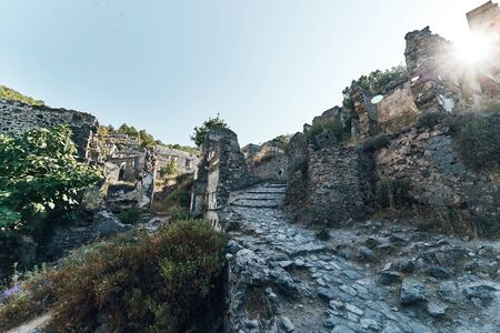 The abandoned Greek village of Kayakoy, Fethiye, Turkey. Ghost Town Kayakoy. Turkey, evening sun. Ancient abandoned buildings of rock and stone Standard-Bild