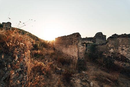 The abandoned Greek village of Kayakoy, Fethiye, Turkey. Ghost Town Kayakoy. Turkey, evening sun. Ancient abandoned buildings of rock and stone.