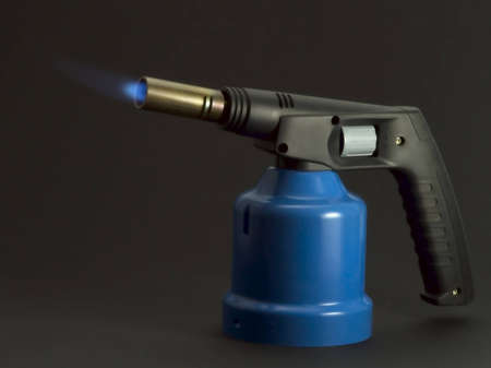 A blowlamp with cartridge on black background photo
