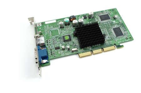electrolytic: Una tarjeta gr�fica AGP con el sistema de bus en el fondo blanco Foto de archivo