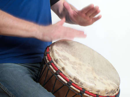 drum and bass: The image shows an adult playing his djembe