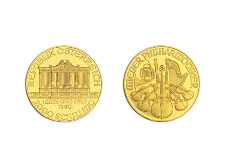 an ounce: The image shows the front- and rear side of a gold coin called Wiener Philharmoniker Stock Photo