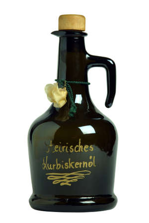 pumpkinseed: The image shows a cut out bottle filled with styrian pumpkinseed oil