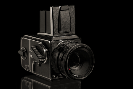The image shows a medium format camera over black