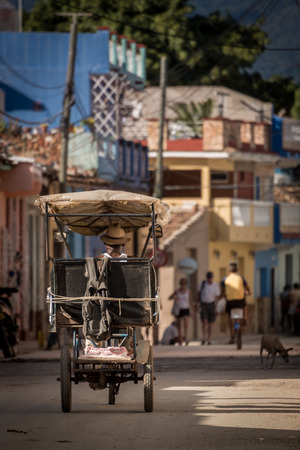 Cuban bicycle (bici) taxi in the street with a cake Banco de Imagens