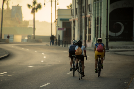 Travelling by bicycle early in the morning in Havana, Cuba