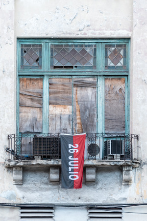 Old windows setting with red and black flag