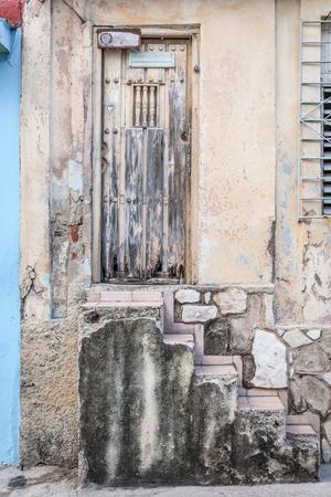 Old worn out doorway in Havana, Cuba
