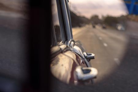 Mirror look at the sun setting in old vintage car at Havana, Cuba Banco de Imagens