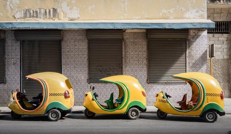 Small cuban coco taxis in line Banco de Imagens