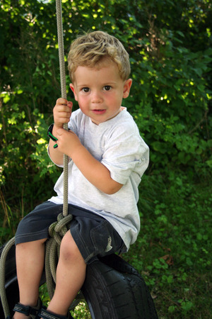 tire: Little Boy on a Tire Swing