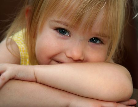 pouty: girl smiling with arms crossed