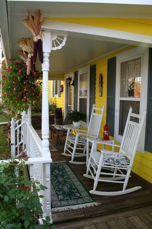 inn: Porch with rocking chairs Stock Photo