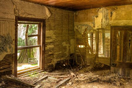Crumbling interior of a long abandoned 19th Century farmhouse. Photographed in New Zealand