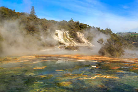 Orakei Korako geothermal area, New Zealand. Steam rising from the colorful hot springs Banco de Imagens