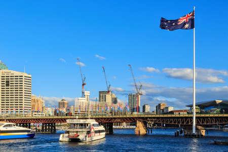 Sydney, Australia - May 29 2019: A giant Australian flag next to the historic Pyrmont Bridge in Darling Harbour, Sydney