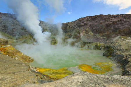 The steaming crater lake of White Island, an active volcano off the coast of New Zealand