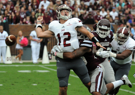 Mississippi State's Brandon Bryant (20) forces a fumble from Troy quarterback Brandon Silvers
