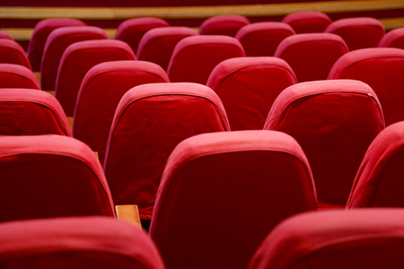 entertaiment: ndoor scenery showing a movie theater with red seats