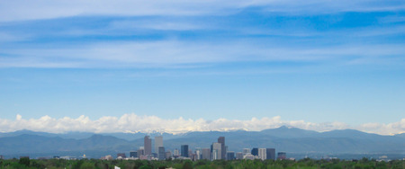Downtown Denver Colorado with snow capped mountains in the background Stock Photo