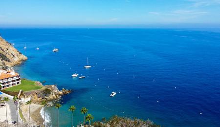 Pleasure boats moored in a small bay off of Santa Catalina Island California Stock Photo
