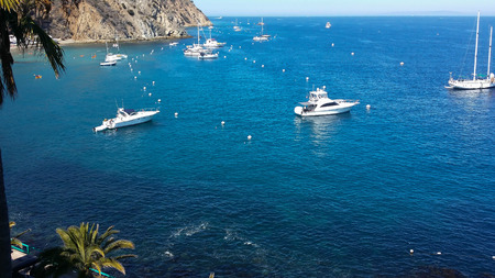 Boats at anchor on beautiful blue water of Santa Catalina Island California